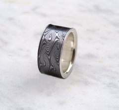 Pattern welded ring with silver lining