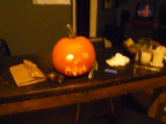 P1040668me n lilly cut pumpkins with a blade.